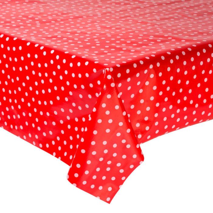 Mantel de hule rojo con topos blancos